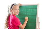 education girl writing on blackboard