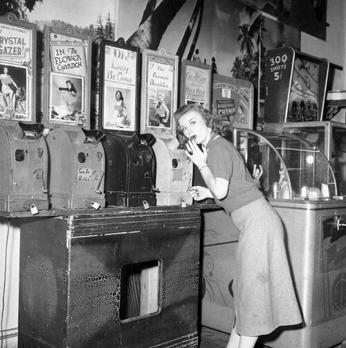A showgirl visits a peep show, 1954