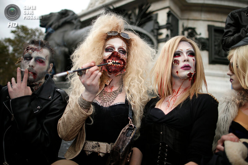 Four men dressed as zombies participate in a Zombie Walk procession in the streets of Paris