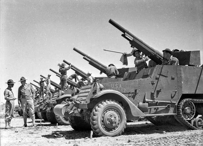 "Apr. 20, 1942: Mobil artillery unit about to start on maneuvers on the desert east of Indio. This photo was published on page one of the Apr. 21, 1942 Los Angeles Times. On negative is written ""tank destroyers."""