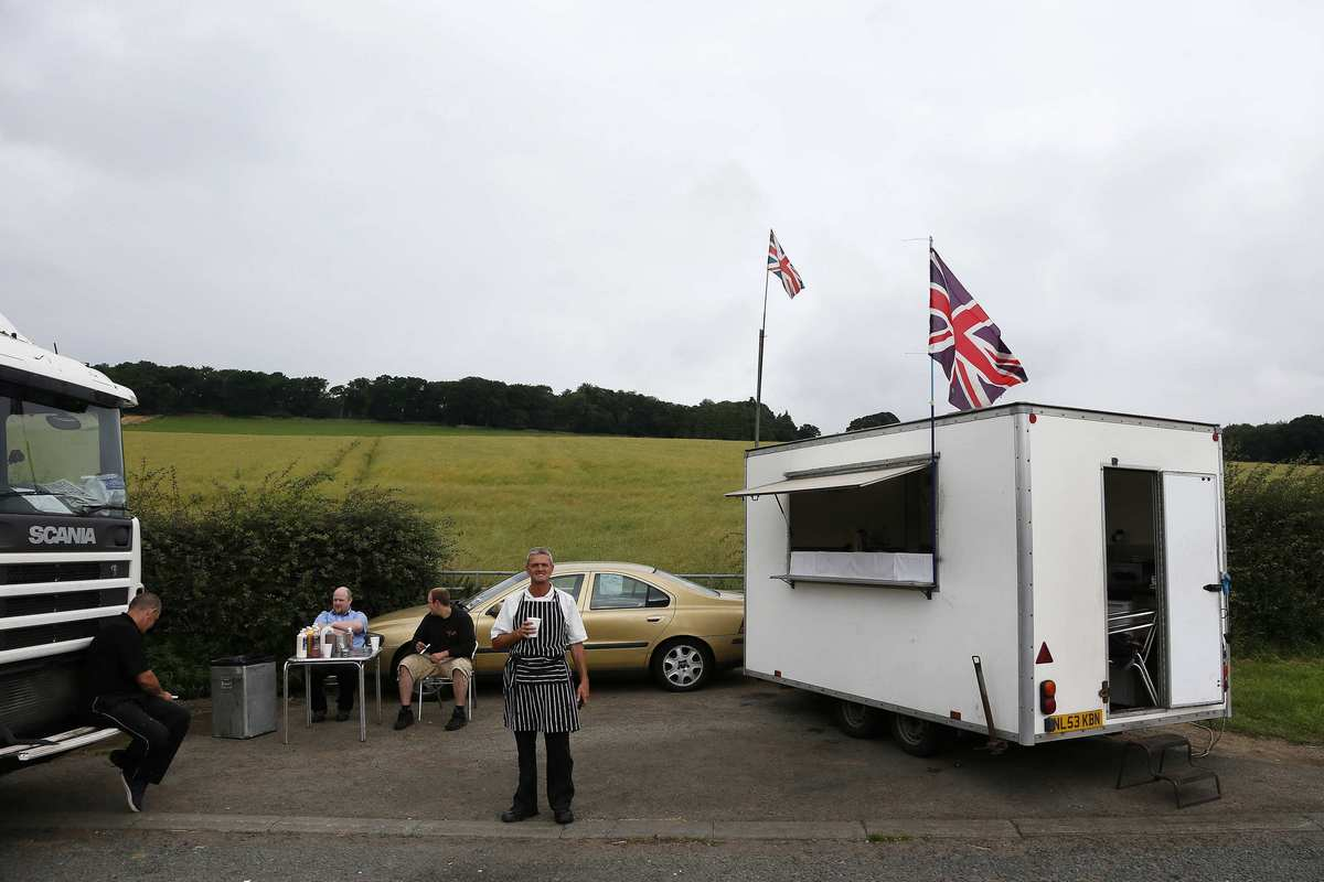 Danny poses for a photograph next to his snack trailer along the A69 near Newton