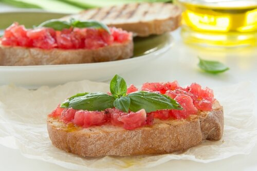 Bruschetta with tomato, basil and olive oil.