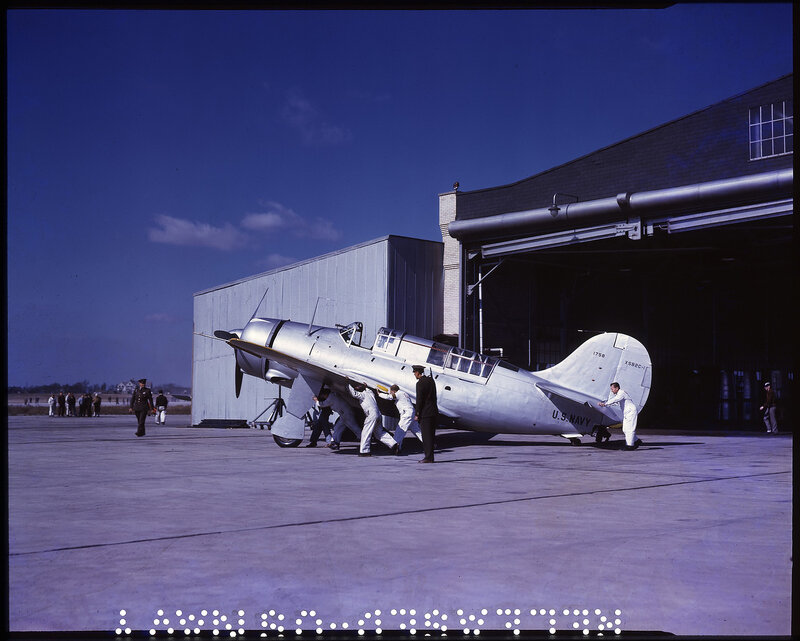 Left side view of U. S. Navy Curtiss XSB2C-1 Helldiver (BuNo 1758) being wheeled out of a hangar in Buffalo, New York, circa 1941.