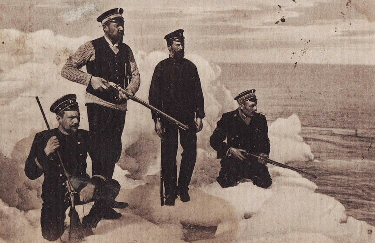 Russian naval officers hunting seals on an iceberg in the Arctic, c. 1900-10's.