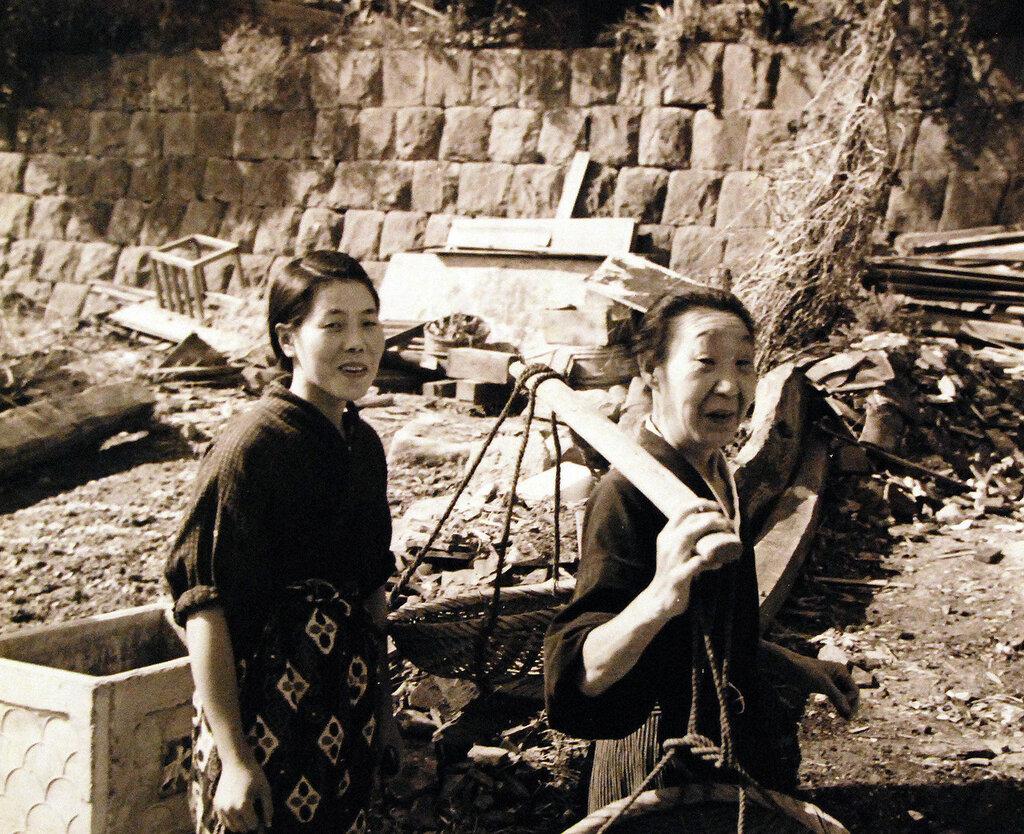 Scene at Sasebo, Kyushu, shows housewives on way to market. October 19, 1945