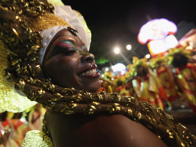 SALVADOR, BRAZIL - FEBRUARY 17:  Revelers parade on the second day of Carnival celebrations on February 17, 2012 in Salvador, Brazil. Carnival is the grandest holiday in Brazil, annually drawing millions in raucous celebrations culminating on Fat Tuesday