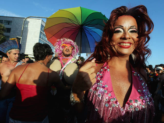 RIO DE JANEIRO, BRAZIL - FEBRUARY 18: Brazilian revelers walk during Carnival celebrations along Ipanema beach on February 18, 2012 in Rio de Janiero, Brazil. Carnival is the grandest holiday in Brazil, annually drawing millions in raucous celebrations cu