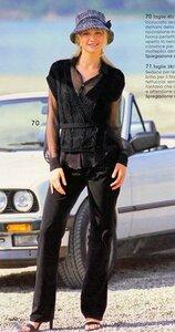 Стильная черная жилетка с поясом спицами