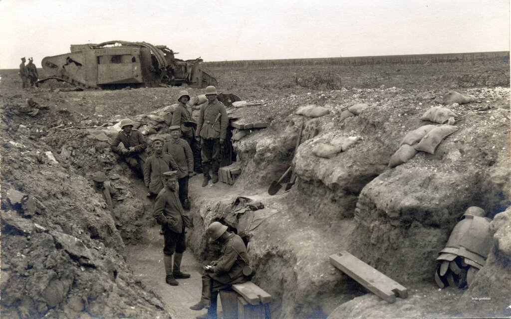 A knocked out British Mark II tank next to a German occupied trench near Bullecourt, 1918. A dugout was made underneath the tank making a well protected command center.
