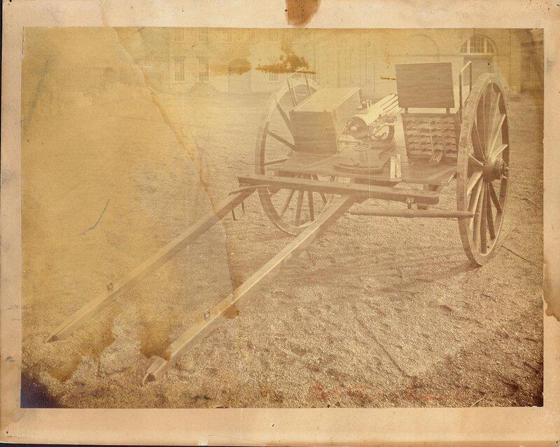 A Colt Model 1876 Gatling Gun sits on a cavalry cart for short model Gatlings.
