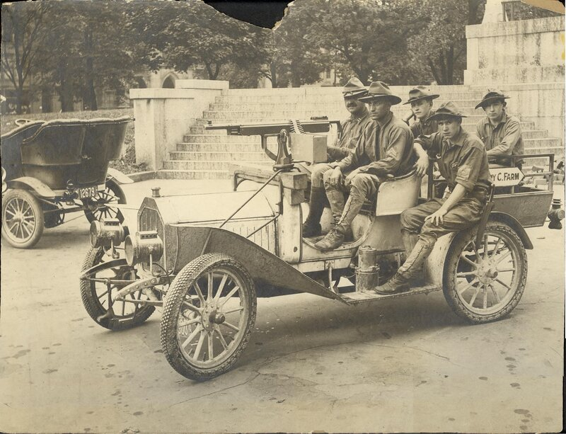 Description - M1895 Colt-Browning machine gun jury-rigged to dashboard of an early truck, with five soldiers.Notes - Creator -Date Created - undatedObject Type - Gelatin silver printsSource Original - 1 gelatin silver print : sepia ; 9 3/4 x 12