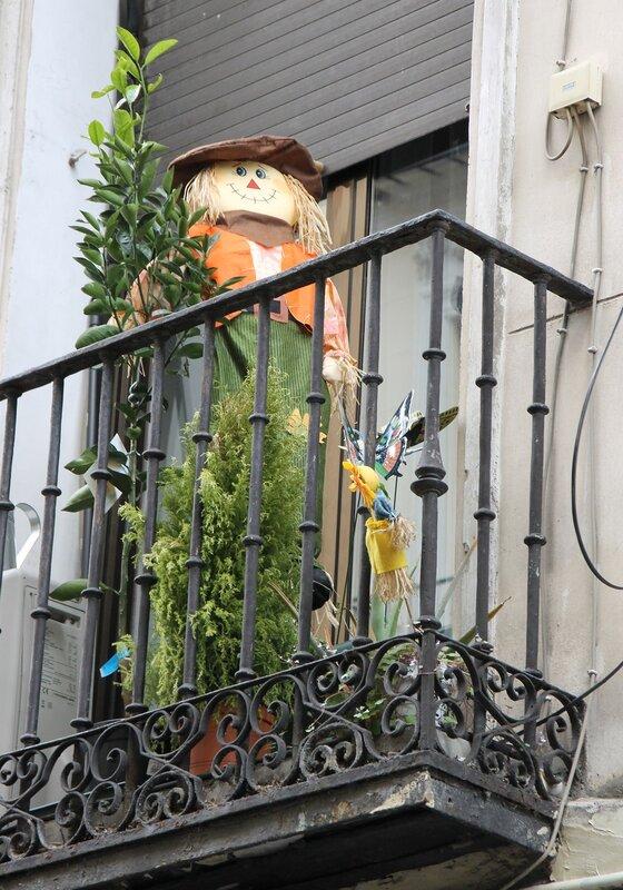 Madrid. Calle del León, stuffed Scarecrow on the balcony
