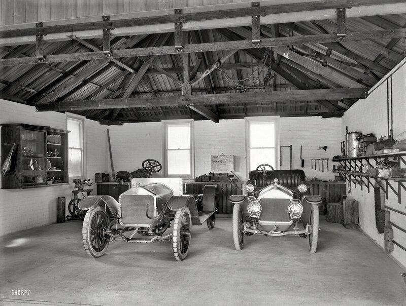 Christchurch, New Zealand, circa 1908. Wolseley and Cadillac motor cars in garage