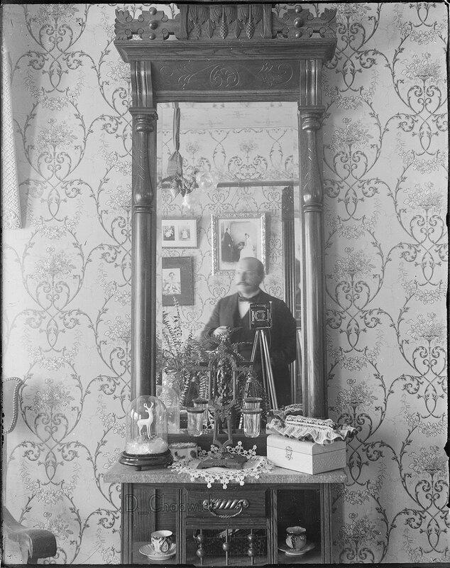 Old-School Selfie A man taking a self-portrait of himself in a mirror.