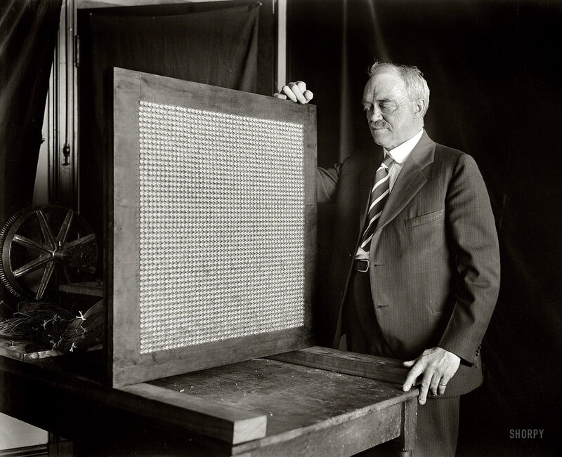 Washington inventor and television pioneer Charles Francis Jenkins (1867-1934), pictured here with what might be considered an early flat-panel video display, its 48-pixel-square grid composed of small neon lamps