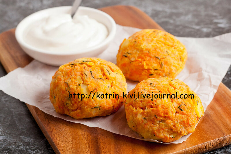 Healthy vegetarian cutlets with potato, carrot, onion and green against the backdrop of sour cream sauce