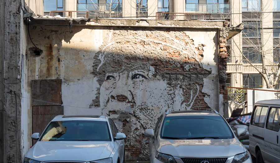 A face carved into a wall, photographed on January 26, 2016.