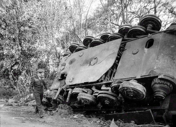 General Eisenhower examines the wreck of a Tiger II in Normandy, August 1944.