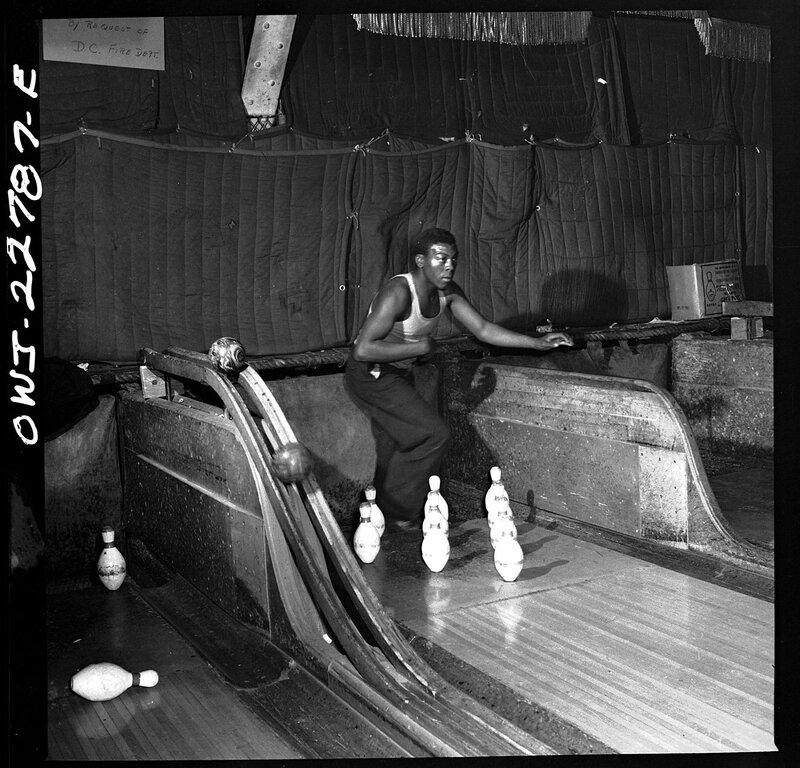 A pin boy working at a bowling alley, Washington DC, April 1943.