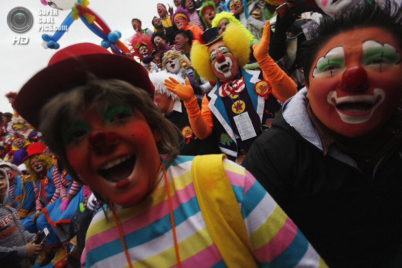 Clowns laugh for fifteen minutes as they rally for peace during 18th Latin American clown convention or