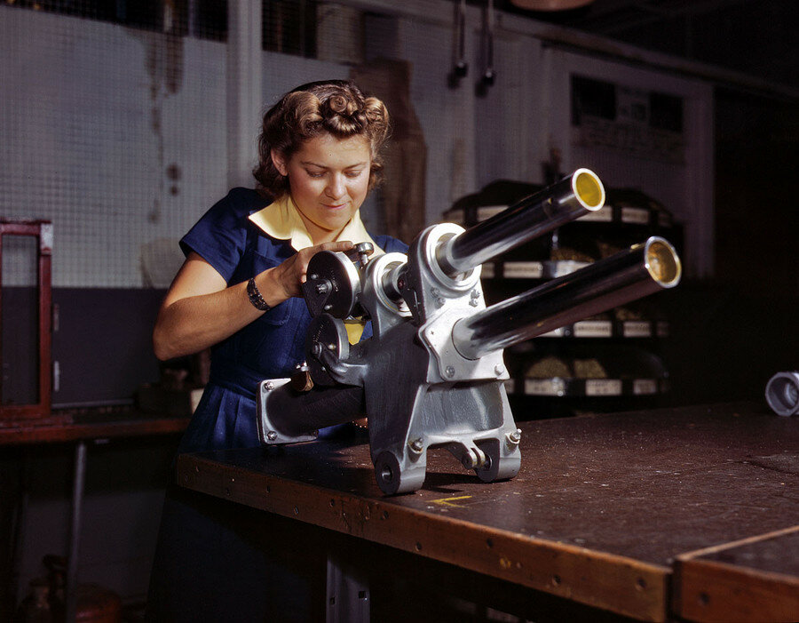 "October 1942. Inglewood, California. ""Young woman employee of North American Aviation working over the landing gear mechanism of a P-51 fighter plane."".jpg"
