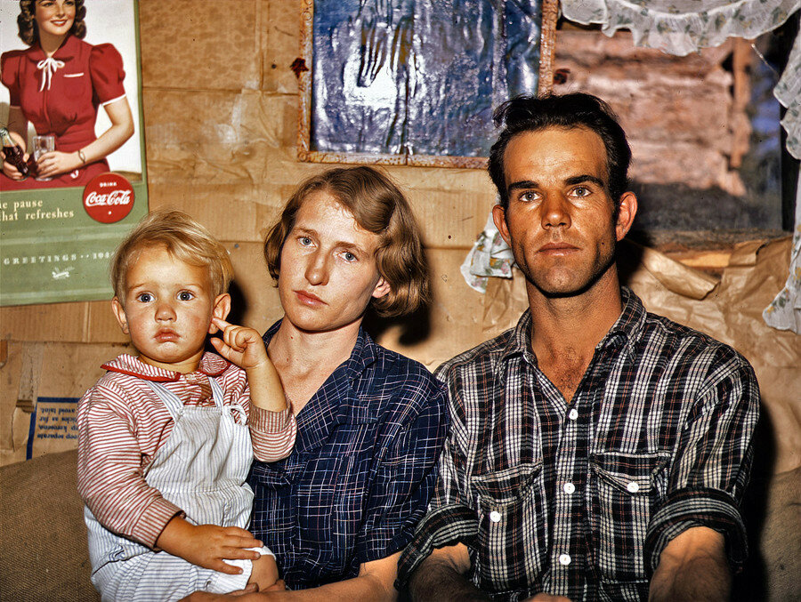 September 1940. Jack Whinery, Pie Town, New Mexico, homesteader, with his wife and the youngest of his five children in their dirt-floor dugout home.jpg