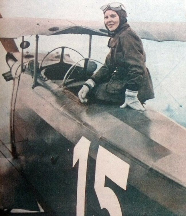 Sabiha Gken of Turkey poses with her plane, in 1937 she became the first female fighter pilot..jpg