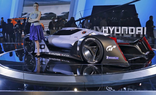 "A model poses next to Hyundai sports concept car ""Muroc"" at the Indian Auto Expo in Greate"