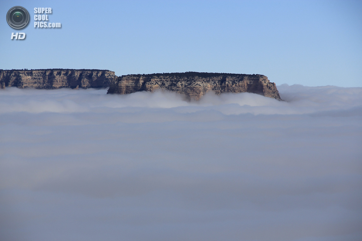 A rare total cloud inversion is pictured from Shoshone Point on the South Rim of the Grand Canyon National Park in Grand Canyon, Arizona