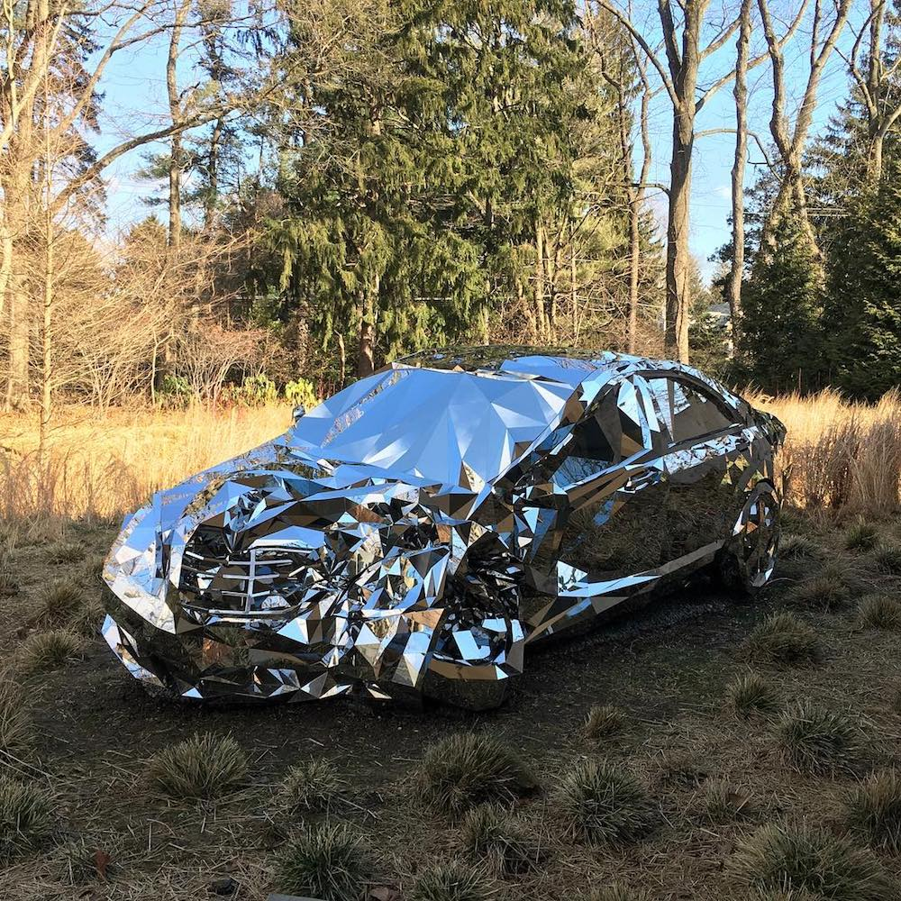 A Wrecked Luxury Car Built From Over 12,000 Reflective Steel Parts (5 pics)