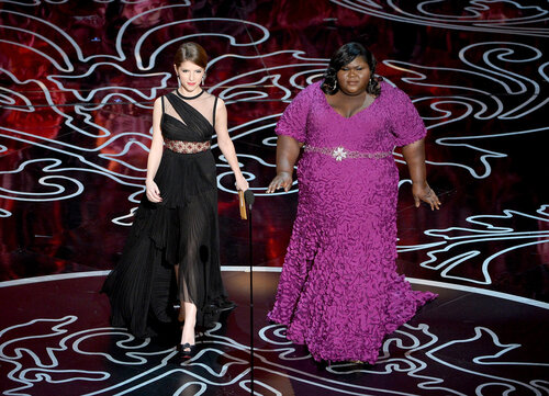 HOLLYWOOD, CA - MARCH 02: Actresses Anna Kendrick (L) and Gabourey Sidibe speak onstage during the Oscars at the Dolby Theatre on March 2, 2014 in Hollywood, California. (Photo by Kevin Winter/Getty Images)