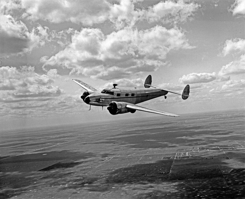 A Lockheed Model 12A Electra Junior, belonging to the Superior Oil Company, banking while in flight over Houston, Texas. March 1940