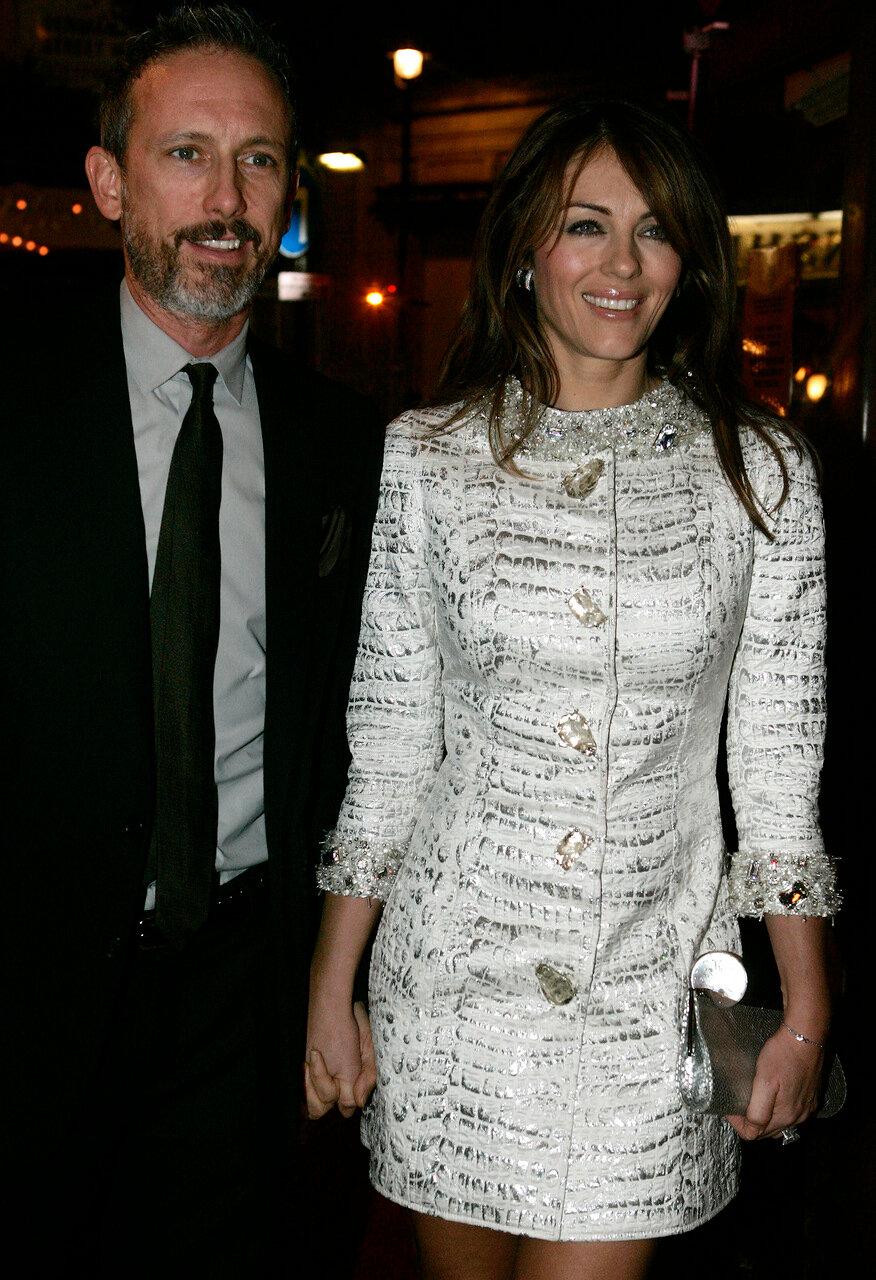 British actress Elizabeth Hurley with shoe designer Patrick Cox arriv