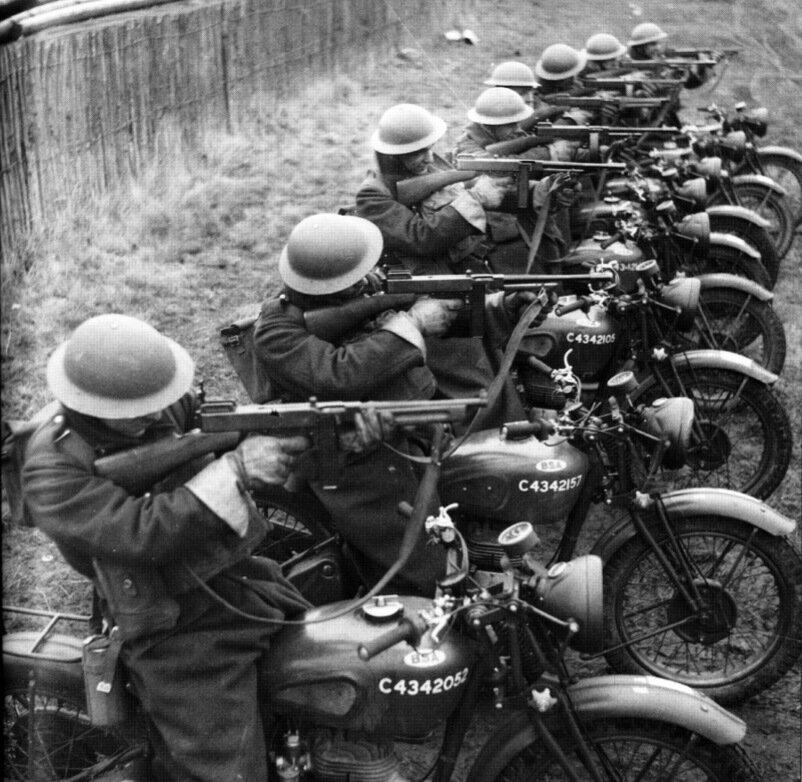 British Army motorcyclists on their BSA models show off their firepower.jpg