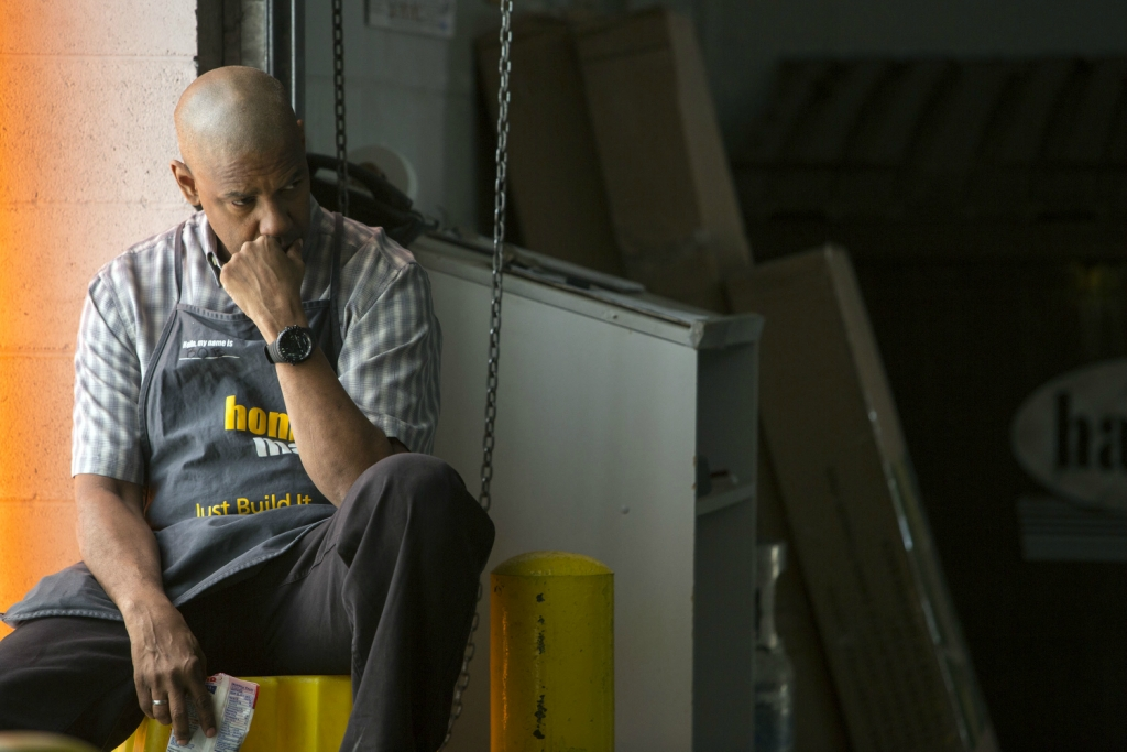 Robert McCall (DENZEL WASHINGTON) takes a break while working at Home Mart in Columbia Pictures' THE EQUALIZER.