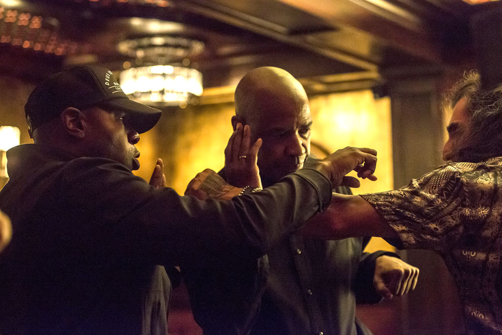 Director Antoine Fuqua (left) rehearses the stunt with Denzel Washington (center) and Alex Veadov on the set of Columbia Pictures' THE EQUALIZER.