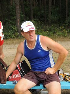 Районный турнир по пляжному волейболу. П. Дубровка, 10 августа 2014 года. Иван Иванович внимательно следит за игрой своих спортсменов.