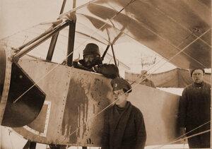 Военный лётчик отряда есаул Ткачев в кабине летательного аппарата.