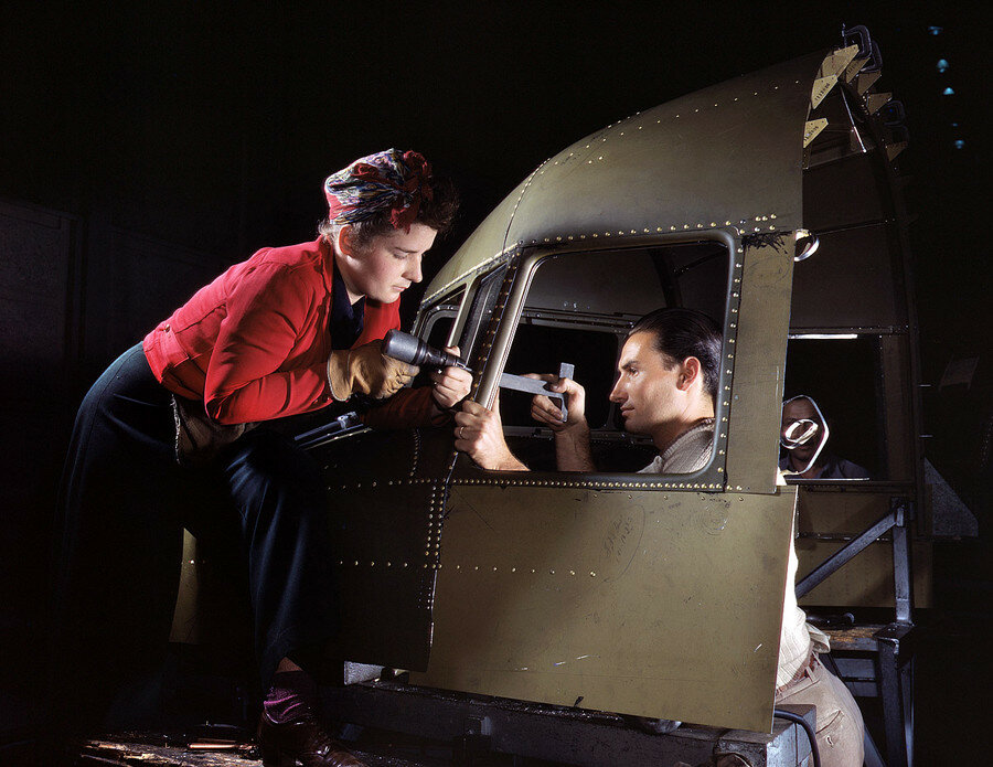 "1942. Inglewood, California. Riveting team working on the cockpit shell of a C-47 heavy transport at North American Aviation. ""The versatile C-47 performs many important tasks for the Army.jpg"