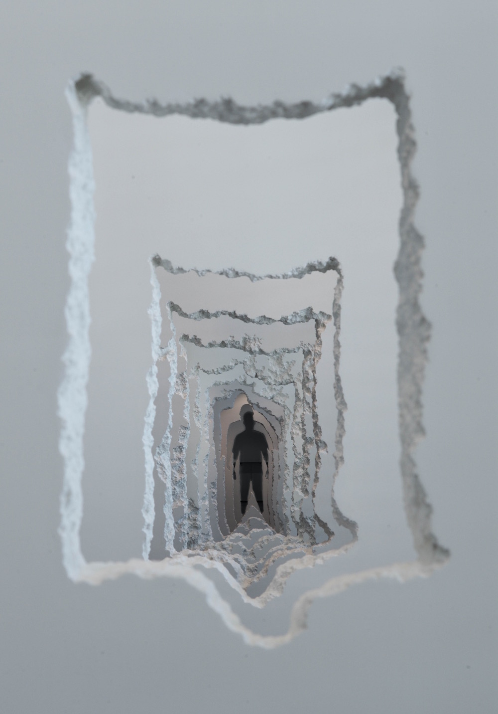 A 300-Foot Tunnel Excavated Through Walls Examines the Creative and Destructive Powers of Mankind