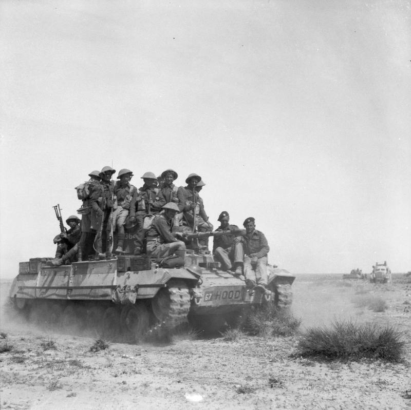 A Valentine tank carries infantry during an exercise, 12 March 1943.