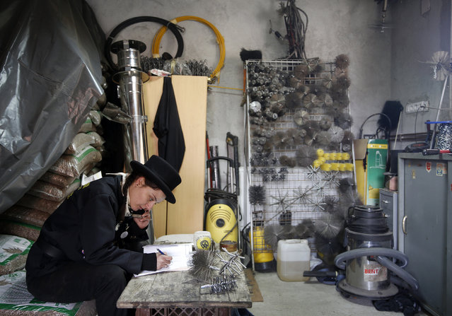 Dajana Djuric, 25, who has worked as a chimney sweep since the age of six, prepares in her office be