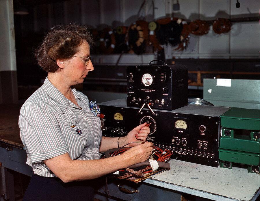 October 1942. Testing electric wiring at Douglas Aircraft Company. Long Beach, California..jpg