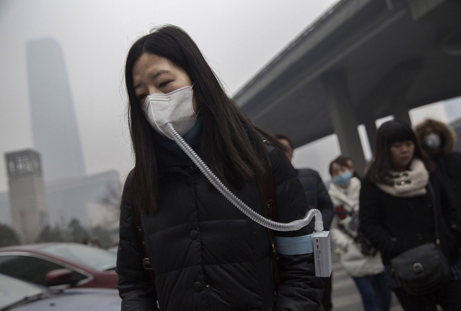 A Chinese woman wears a mask and filter as she walks to work during heavy pollution on December 9, 2