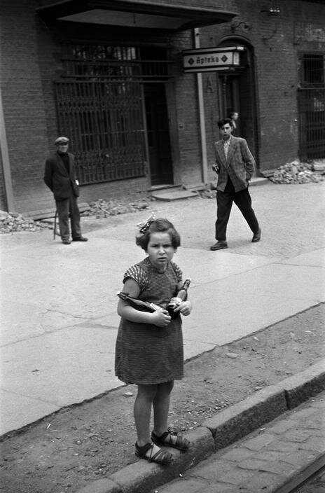 Little girl carrying home beers for dinner, Upper Silesia, Poland, 1950s. [Erich Lessing]
