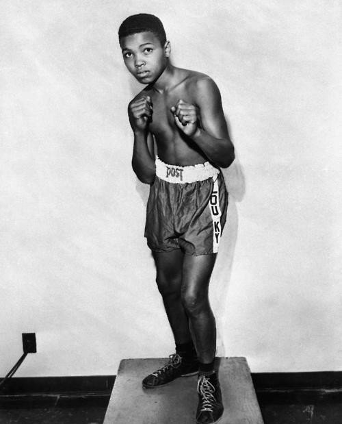A 12-year old Muhammad Ali, then Cassius Clay, strikes a pose in 1954..jpg