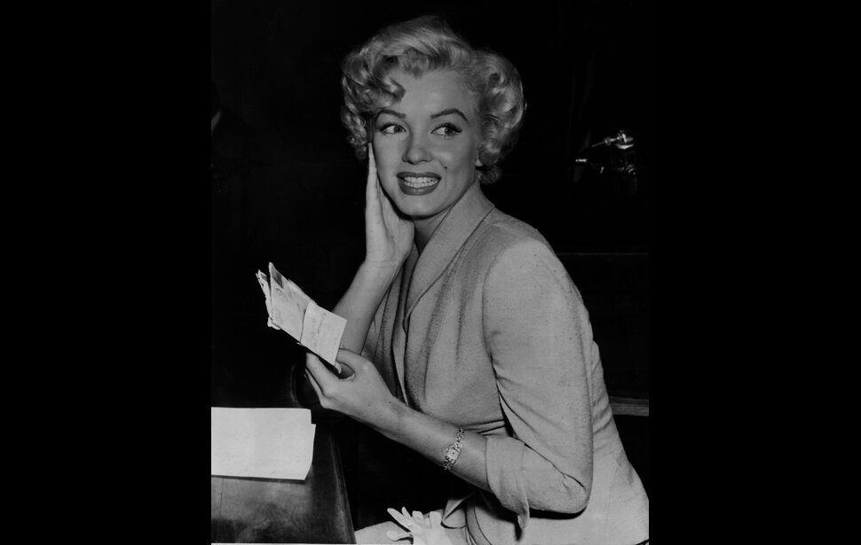Marilyn Monroe in court to testify against two men accused of distributing nude photos and wrongfully using Monroe's name in an advertisement, 1952.