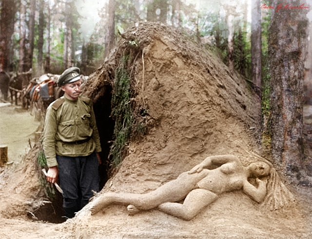 russian_scout_alekseev_and_his_sculpture_of_sand_by_klimbims-d73d61w.jpg
