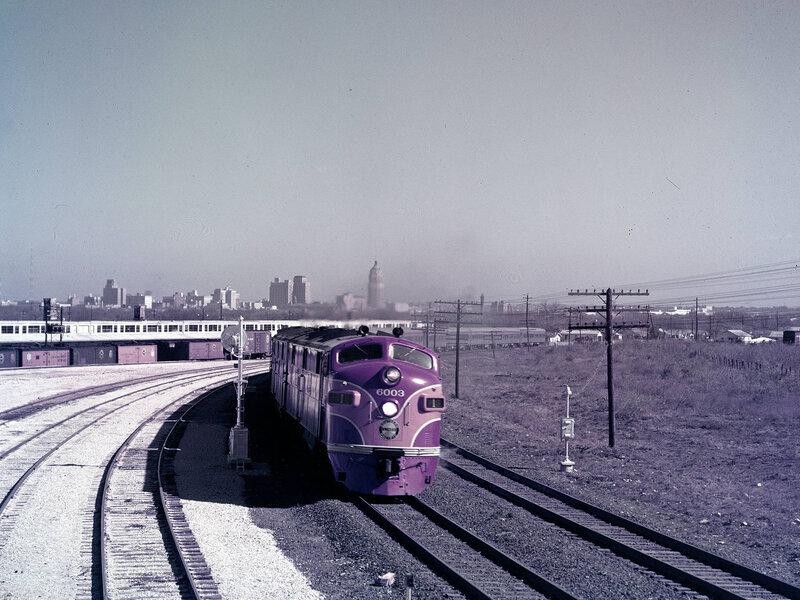 Southern Pacific Railroad Locomotive No. 6003 and Sunset Limited Train Leaving Houston. Houston, Texas. Ektachrome, 1951.
