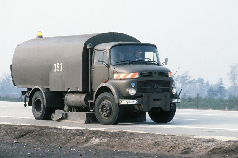A flight line sweeper vehicle is operated on the autobahn during an aircraft landing exercise.